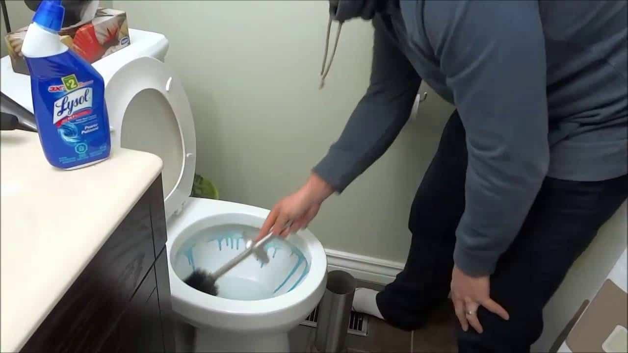 scrubbing toilet bowl